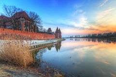 The Castle of the Teutonic Order in Malbork at sunset Stock Photography