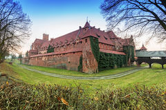 The Castle of the Teutonic Order in Malbork at sunset Royalty Free Stock Image