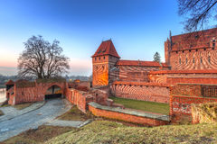 The Castle of the Teutonic Order in Malbork at sunset Stock Images