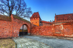 The Castle of the Teutonic Order in Malbork at sunset Royalty Free Stock Photo