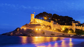 Castle of Tossa de Mar at night, Spain royalty free stock image