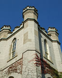 Castle Tower. Closeup of a castle tower set against a blue sky Royalty Free Stock Photos