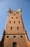 Castle tower. Large castle tower on a blue sky background Stock Photo