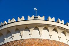 LUBLIN, POLAND - Juni 07, 2018: The top of the Lublin Castle tower with an ax stock image