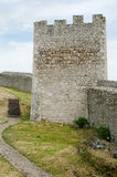 Castle tower. Old repaied gothic castle tower and bit of coutyard royalty free stock photography