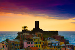 Castle tower silhouette view of famous travel landmark destination Vernazza, a small mediterranean old sea town, Cinque Stock Photos