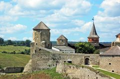 Castle tower and sky. Old castle tower and wall in Ukraine Royalty Free Stock Photography