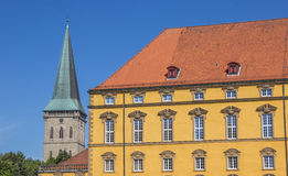 Castle and the tower of St. Katharinen church in Osnabruck Stock Photo