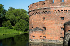 The castle tower is surrounded by a water moat. The castle tower is surrounded by water located in Kaliningrad Stock Photo