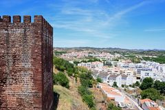 Castle tower and town buildings, Silves, Portugal. Medieval castle tower with views over the city rooftops, Silves, Portugal, Europe royalty free stock photography