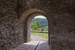 Castle tower, Wehrturm Elsterberg, Burg Ruine. View to the forest from the gate of medieval stonewalls of the Burgruine Elsterberg Royalty Free Stock Image
