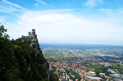 Castle and town. Castello della Guaita and birdview of San Marino, Italy - panoramic mode Royalty Free Stock Photo