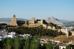 Castle and town, Antequera, Spain. Castle fortress with townhouses in the foreground and the lovers rock to the rear, Antequera, Malaga Province, Andalucia Stock Image