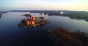 The castle of Trakai. Aerial view flight from above, famous Lithuanian places bird's eye view stock video footage