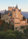 Castle and trees at sunset in Segovia. Alcazar. Royalty Free Stock Images