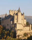 Castle and trees at sunset in Segovia. Alcazar. Stock Photo