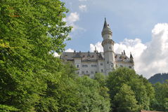 Castle among the trees. A view of one small side of the Neuschwanstein Castle in Germany. The famous Disney castle Stock Images