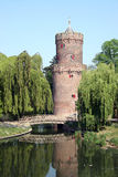 Castle turret. Overlooking reflective pond in city park of Nijmegen royalty free stock photography