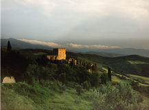 Castle in Tuscany. This castle sits in the Val d'Orcia region of Tuscany. Shot on medium-format slide film and scanned Stock Image