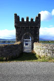 Castle type gateway. View of a gateway built like a castle turret against a blue sky Stock Photography
