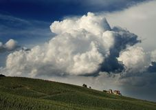 Castle under the clouds. The Torrechiara's castle under a group of clouds.In the foreground a vineyard stock images