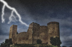 Castle under the storm. With rain and lithnings Stock Image