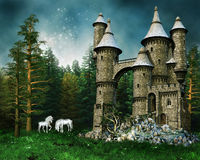 Castle and unicorns on a meadow. Fantasy castle and white unicorns on a green meadow Royalty Free Stock Image