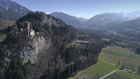 Castle Valley View Swizerland Aerial 4k. Aerial footage of a castle on the cliff in a valley with mountains in the background. Shot in Switzerland in 4k quality stock video footage