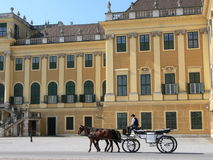 Castle in vienna. Front side of the schoenbrunn castle in vienna with a cab passing by royalty free stock image