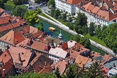 Castle view, Ljubljana, Slovenia. View from the castle of old Ljubljana with river, wooden boat, and rooftops, Slovenia Stock Image