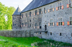 Castle view. Look at an old castle building with a tower and moat Royalty Free Stock Image