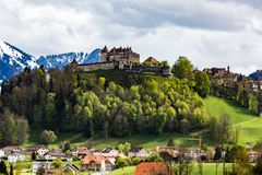 Castle and Village Gruyeres in May 2017 in Switzerland royalty free stock photo
