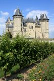 Castle and vineyard in France (Loire region). Picture taken in Saumur. This castle is one of the many Loire castle (chateaux de la Loire), Anjou, France. Built Stock Images