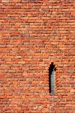 Castle wall. Old brick castle wall and narrow window stock photography