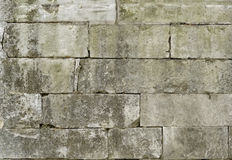 Castle Wall. Fragment of crude aged stone wall Royalty Free Stock Image