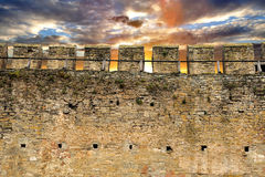 Castle wall. Part of old brick and stone wall Stock Images