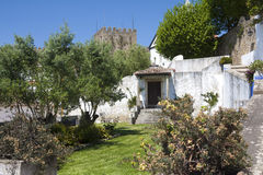 Castle wall attached house. In Obidos, Portugal Stock Images
