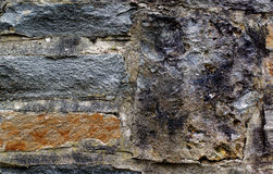 Castle Wall Background. Background of Ancient Castle Wall with Old Stones and Concrete closeup Outdoors royalty free stock image