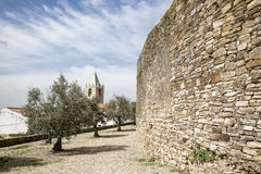 Castle wall and the clock tower in Cabeco de Vide town, Portalegre District, Portugal Royalty Free Stock Photography