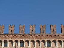 Castle wall detail. Crenellated castle wall and blue sky Stock Photo