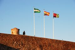 Castle wall and flags, Malaga. Royalty Free Stock Images