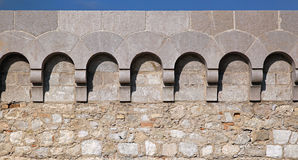 Castle wall. Castle fortification wall with stone arches stock photo