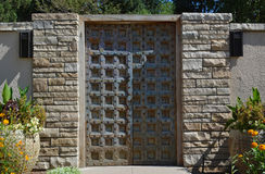 Castle Wall Iron Metal Style Door. A heavy castle-style door with rock borders Stock Images