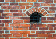Castle wall. Medieval castle wall close-up with a small barred window Royalty Free Stock Photography