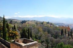 Castle wall and mountain view, Granada. Castle walls (Alcazaba) with views towards the snowy Sierra Nevada Mountains, Palace of Alhambra, Granada, Granada Royalty Free Stock Photos