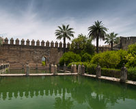 Castle wall and pond in Alcazar of Cordoba Royalty Free Stock Images