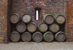 Castle wall prthole and barrels Royalty Free Stock Photos