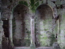 Castle Wall Ruins. Interior castle wall with pillars, arches and patina Stock Photos