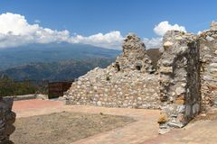 Castle wall in Sicily, Italy. With Mt Etna royalty free stock photos