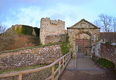 Castle Wall and Tree in Winter. Dramatic looking entrance gate, tower and bridge at Carisbrooke Castle on the Isle of Wight Stock Photo